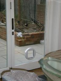CAT FLAP FITTING, through walls, doors, UPVC panels and ...