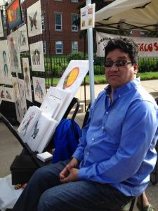 Artist Lloyd Dubois at the annual Cathedral Village Arts Festival.