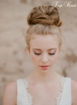 Sleek top knot with big lashes4