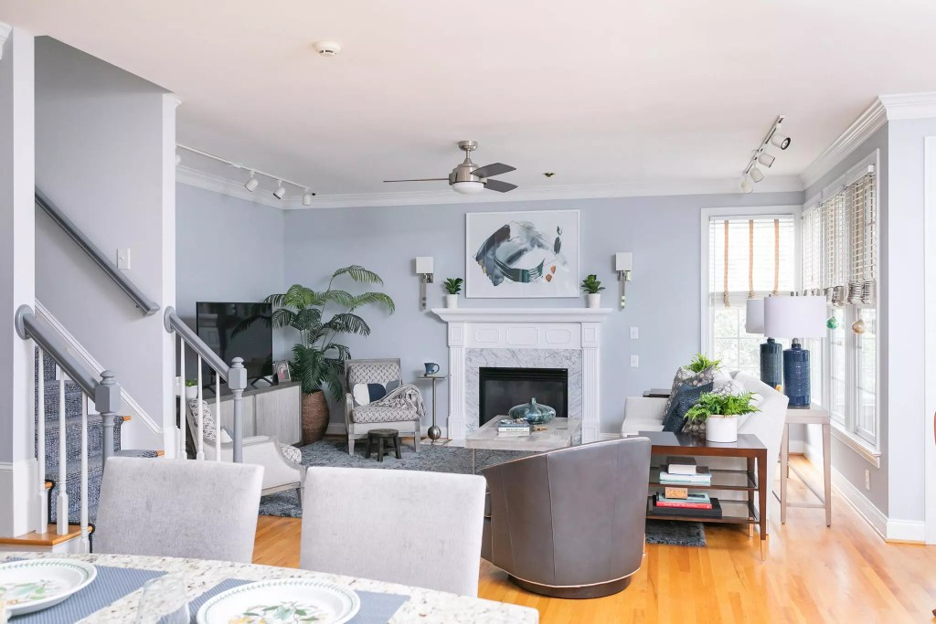 Updated swivel and mantel in a wonderful living room design - Catherine French Design