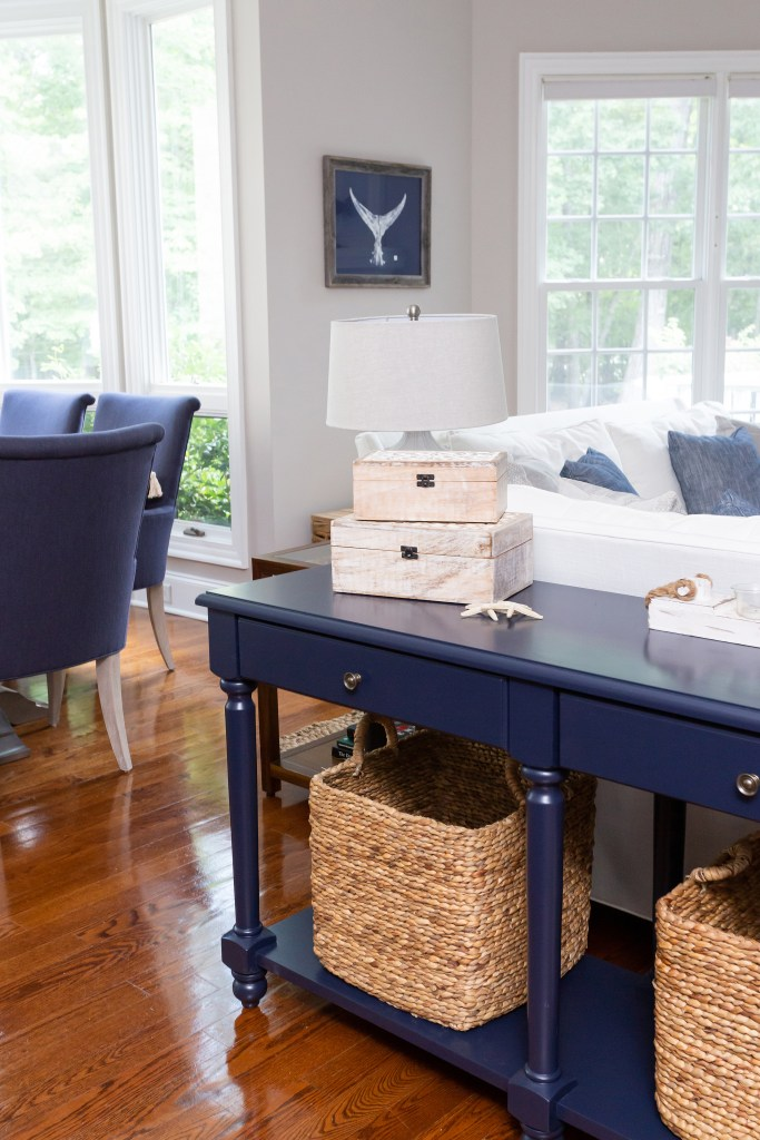 navy console and accents in this coastal siting room - durham nc - cat french design