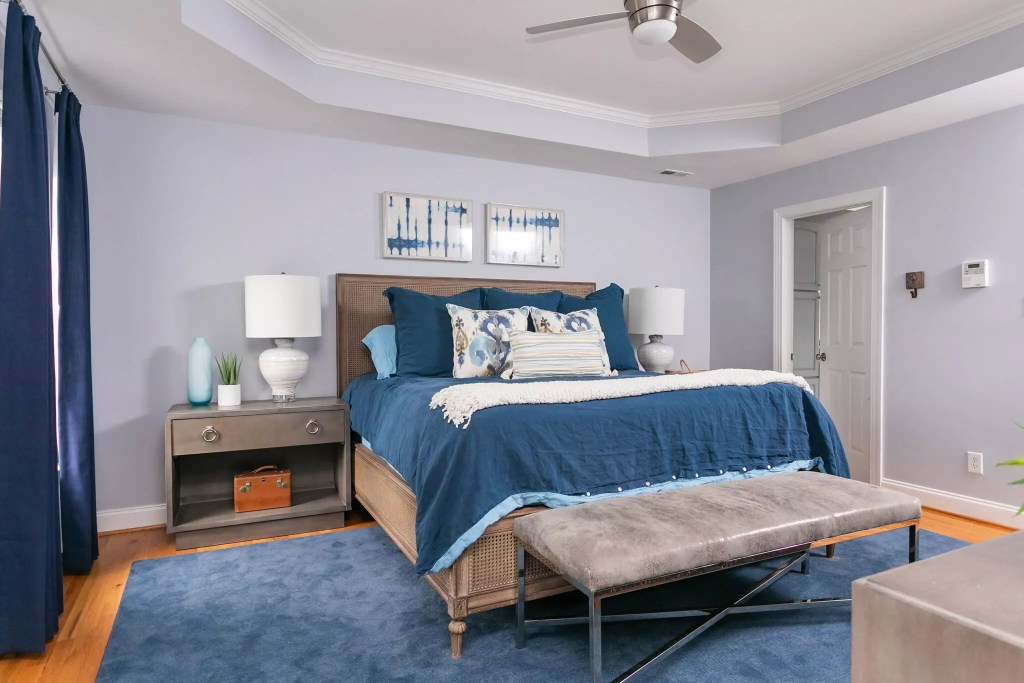 All New Navy bedding, window treatments and art in Chapel Hill Owner's Suite