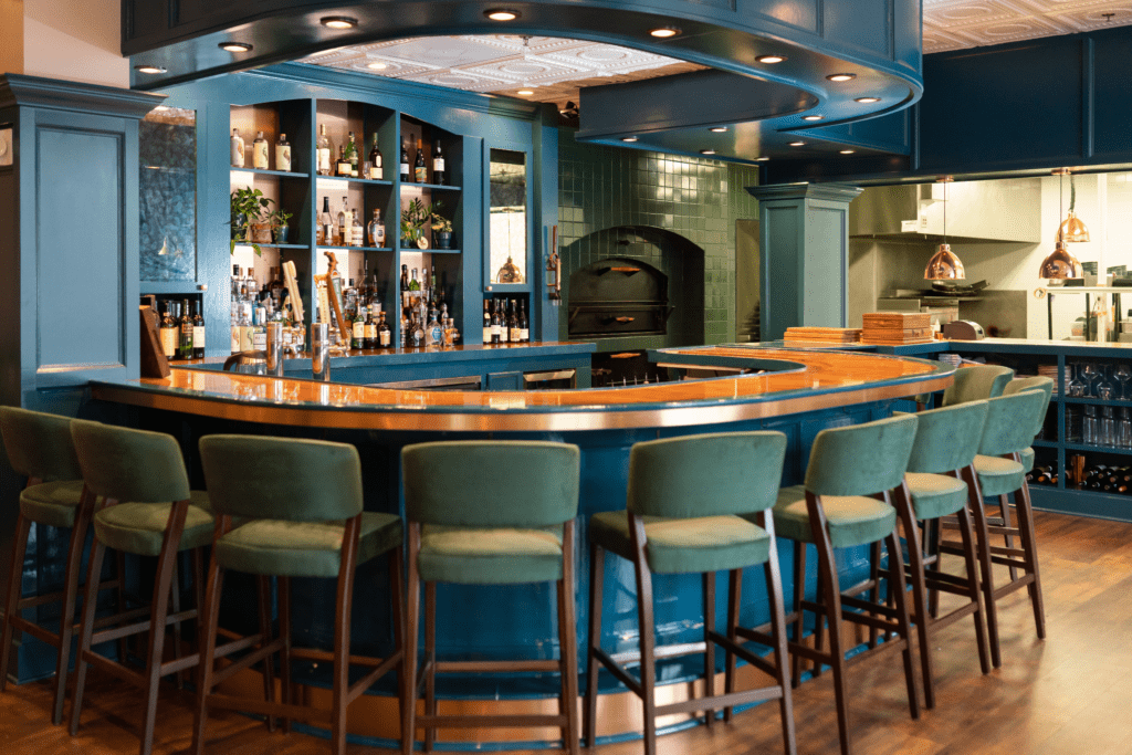 Newly reimagined bar area with copper, blue and hunter accents - Cat French Design