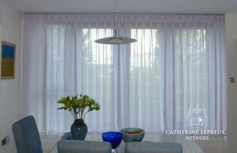 Sheer white voile pinch pleat curtains on a Silent Gliss Metropole in an Edinburgh penthouse kitchen
