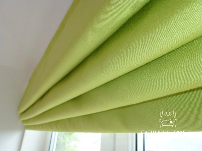 Blackout lined roman blind with cascade pleating in an Edinburgh bedroom