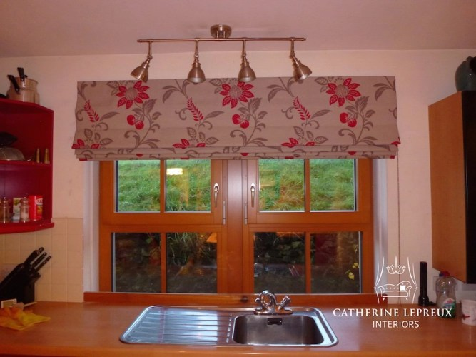 Modern country red floral roman blind at a Fife kitchen window