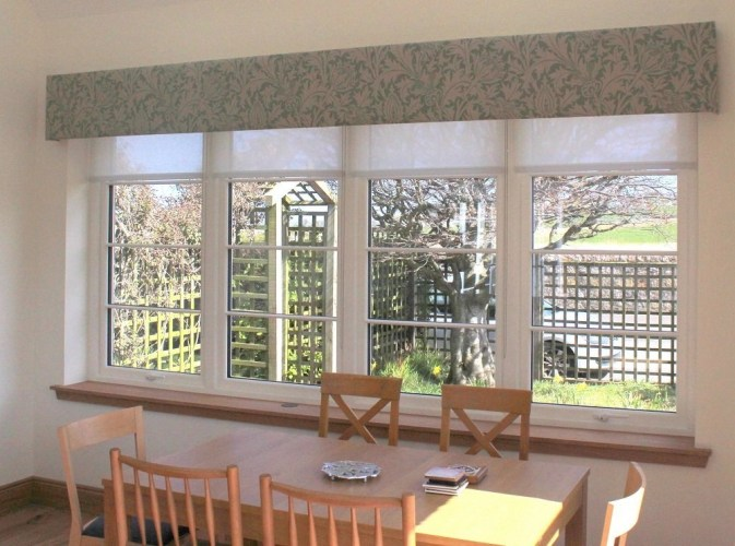 Pelmet upholstered in William Morris Thistle fabric with privacy roller blinds in a St Andrews sun room