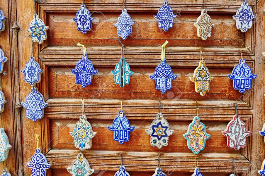 Selection of traditional Moroccan amulets, khamsa, providing defense against the evil eye, on a market in Fes