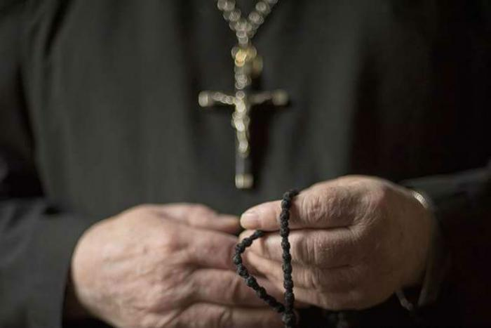 Priest attacked and robbed outside parish.
