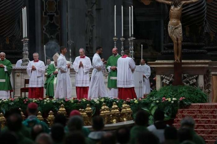 Prisoners serve at Mass with Pope Francis.