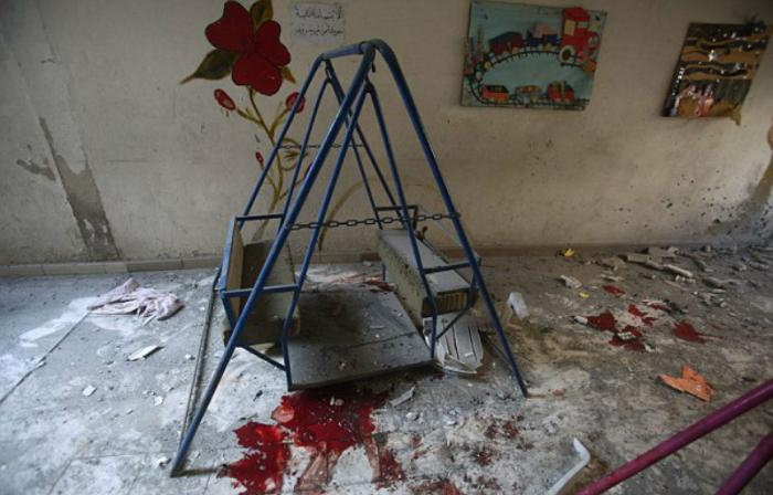 The bloodied play area reveals the heartbreaking attack.