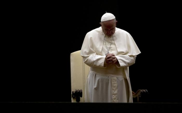 Pope Francis prays at St. Peter