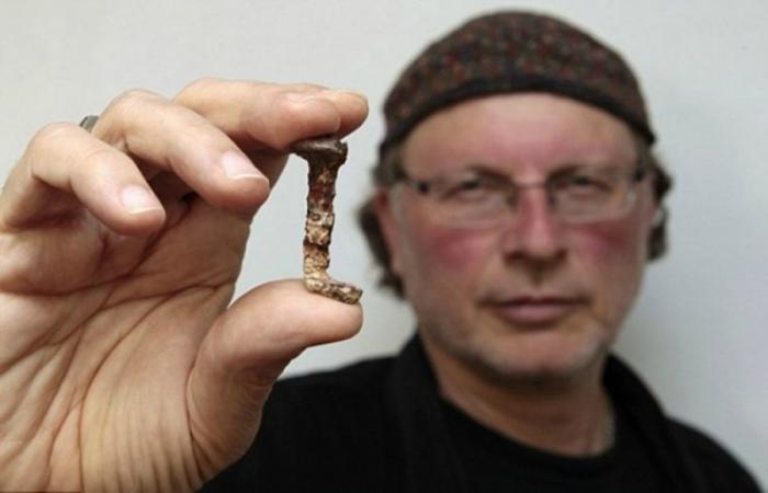Israeli-Canadian archaeologist Simcha Jacobovici holds one of two nails that were said to have been used to hold Jesus on the cross during the presentation of a documentary film at Tel Aviv University in Israel on April 6, 2011..
