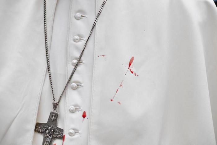 Pope Francis with blood on his cassock