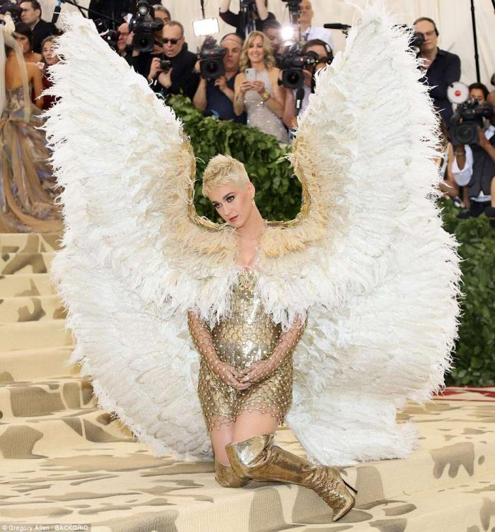 Katy Perry dressed as an angel with giant wings.