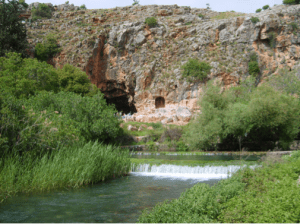 The cave in present times, waters flowing from underground