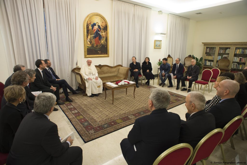 "Pope Francis meets with people involved in the publishing of ""The Name of God Is Mercy"" at the Domus Sanctae Marthae at the Vatican Jan. 11. The book features an interview the pope did with Italian journalist Andrea Tornielli. (CNS photo/L'Osservatore Romano, handout)"