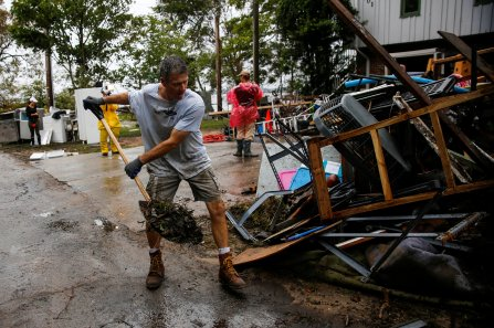 A man clears debris from his home in New Bern, N.C., Sept. 17 following Hurricane Florence. The storm, now a tropical depression, is poised to affect more than 10 million the week of Sept. 17. (CNS photo/Eduardo Munoz, Reuters)