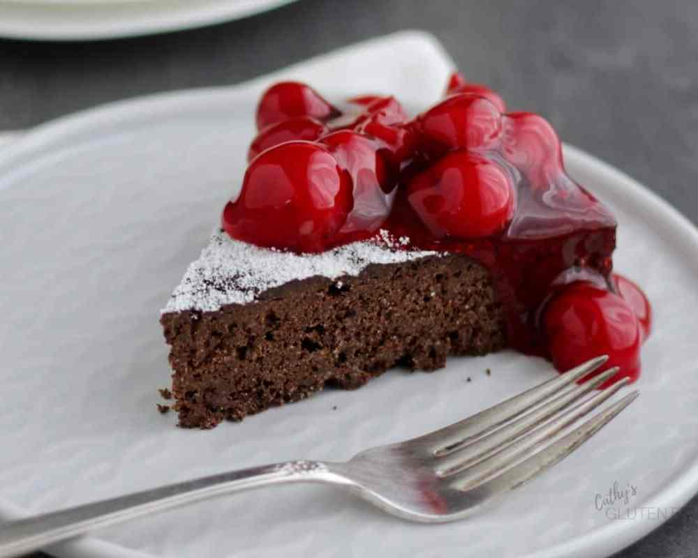 Flourless Chocolate Cake topped with cherries