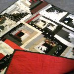 """62"""" x 62"""" all cotton pieced red, black and white quilt, machine quilted with red cotton backing $250"""