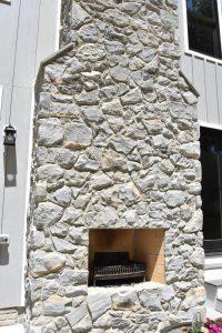 custom stone outdoor fireplace wood-burning