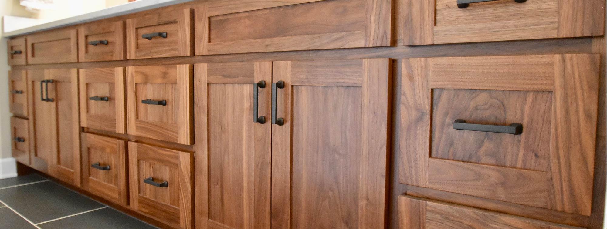 custom cabinets in dark wood finish with modern pulls