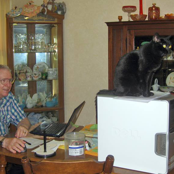 """Midnight Son """"helping"""" his Pops repair a computer -Submitted by Facebook user Faye Nicholas"""