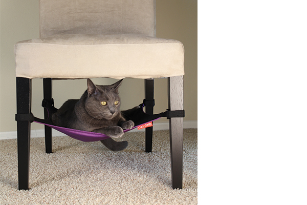 The Cat Crib is an ingenious hammock that easily attaches under most chairs and small side tables, creating a comfy, suspended cat bed. catcrib.com