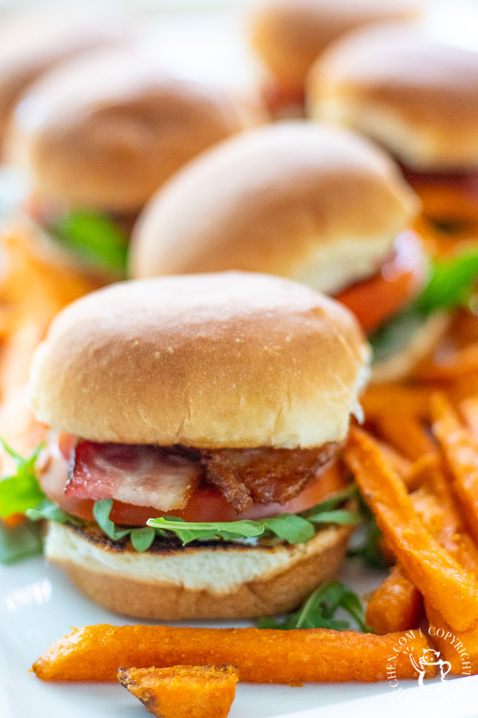 This easy recipe for BLT sliders with arugula and camp sauce is quick, flexible, and works as a main course, or a party or game day appetizer!