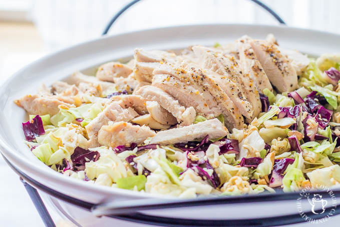 Oriental Chicken Salad is light, yummy, and full of crunch - a perfect summer salad! It's an easy way to feed a crowd - or make sure there will be seconds!