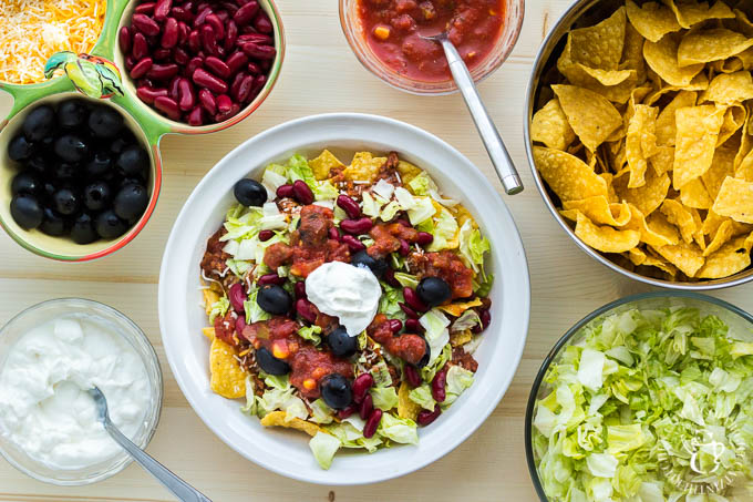 "This recipe for ""trainwreck"" taco salad is simple, inexpensive, easily customizable, and incredibly tasty! It will please your family, or a crowd of almost any size!"