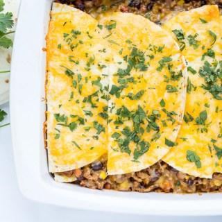 This delicious family favorite Mexican Lasagna recipe is made mostly from ingredients we always have in the pantry and it comes together in just 30 minutes!