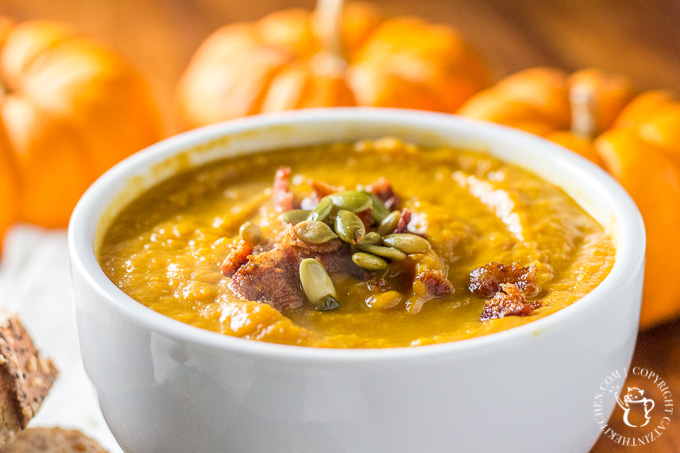 This recipe for pumpkin soup made in the slow cooker is easy, zesty, and bursting with the taste of autumn! Prep in the morning & have an effortless dinner! #pumpkin