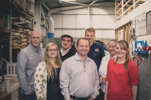 Andy Simpson, CEO of Doncaster Refurnish (centre) with the Refurnish team.