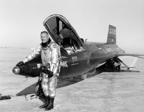 Neil Armstrong posing next to the X-15
