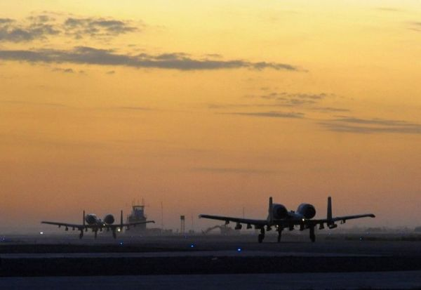 A pair of Fairchild Republic A-10 Thunderbolt IIs of 354th Expeditionary Fighter Squadron taxy down runway at Kandahar Airfield Afghanistan, December 27 2009.