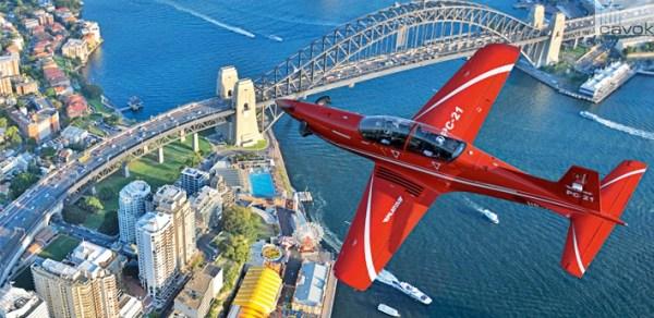 Uma aeronave de treinamento PC-21 sobrevoando Sidney, na Austrália. (Foto: Pilatus Aircraft)