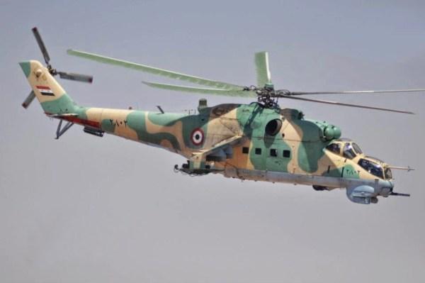 Um helicóptero Mi-25 sírio, semelhante ao que foi abatido pelo ISIS no dia 8 de julho.