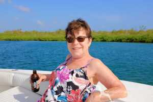lady relaxing on the boat during a mangrove tour in grand cayman