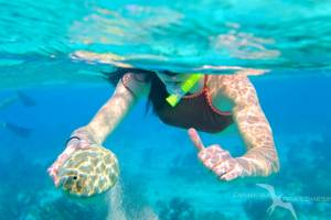 girl snorkeling in grand cayman on a private boat charter