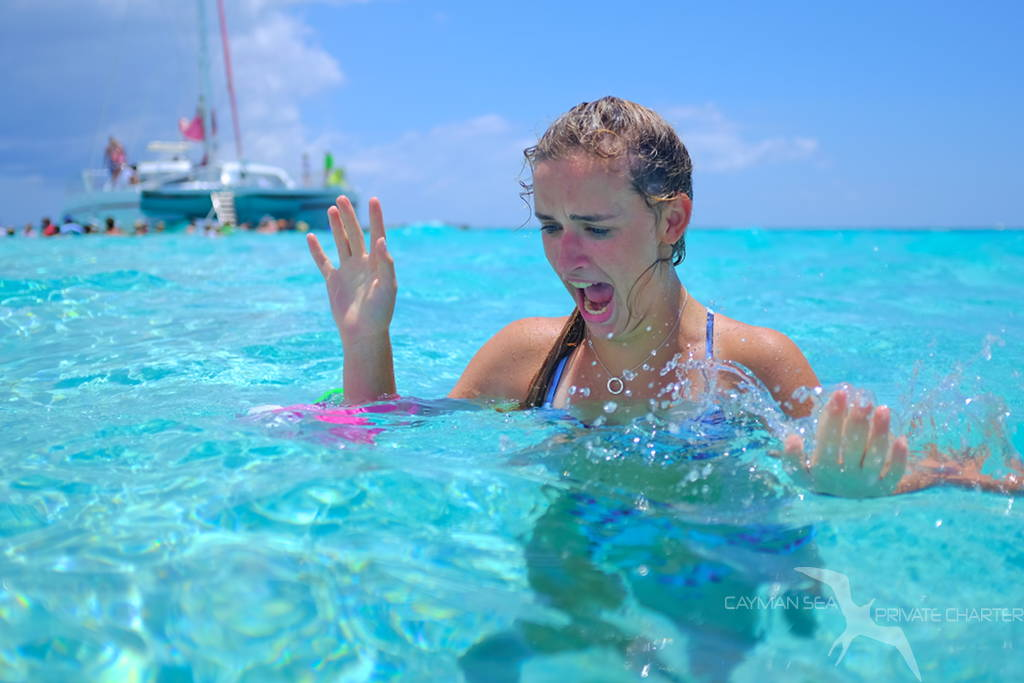girl screaming on a private boat charter to stingray city grand cayman