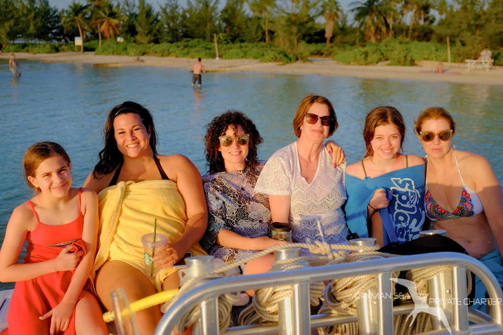 group of ladies on the transom of our charter boat at starfish point grand cayman