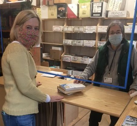 Two volunteers working at Carriage Barn Books