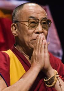 The Dalai Lama gestures during a speech to an arena filled with well-wishers in Ottawa Sunday.