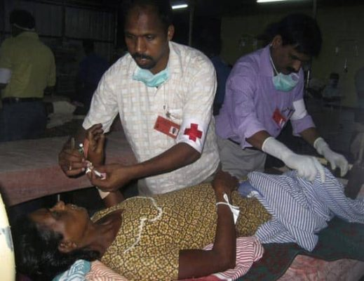 Indian doctors treat an injured Sri Lankan Tamil civilian at the Indian mobile hospital in Pulmudai, about 250 kilometres northeast of Colombo, on Saturday.