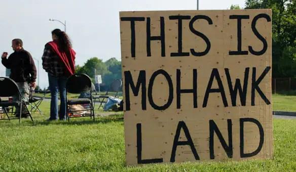 Mohawks gather near the Seaway International Bridge to protest the arming of border guards (Rebecca Zandbergen/CBC)