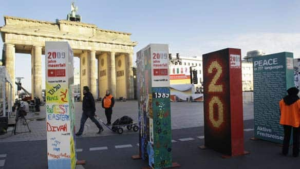 Dominoes set for celebration of the Berlin Wall's destruction.  AP photo by Herbert Knosowski, via Canadian Broadcast System