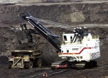 A cable shovel loads a heavy hauler at the Muskeg River mine oilsands development north of Fort McMurray, Alta.