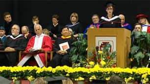 Vic Toews sits just a few feet away from the podium during the University of Winnipeg valedictory address.