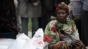 A woman sits on sacks of food in southern Ethiopia. Canada is Ethiopia's fourth largest donor, giving more than $152 million US in 2008.